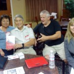 Frank and Karen won the raffle for a travel book.